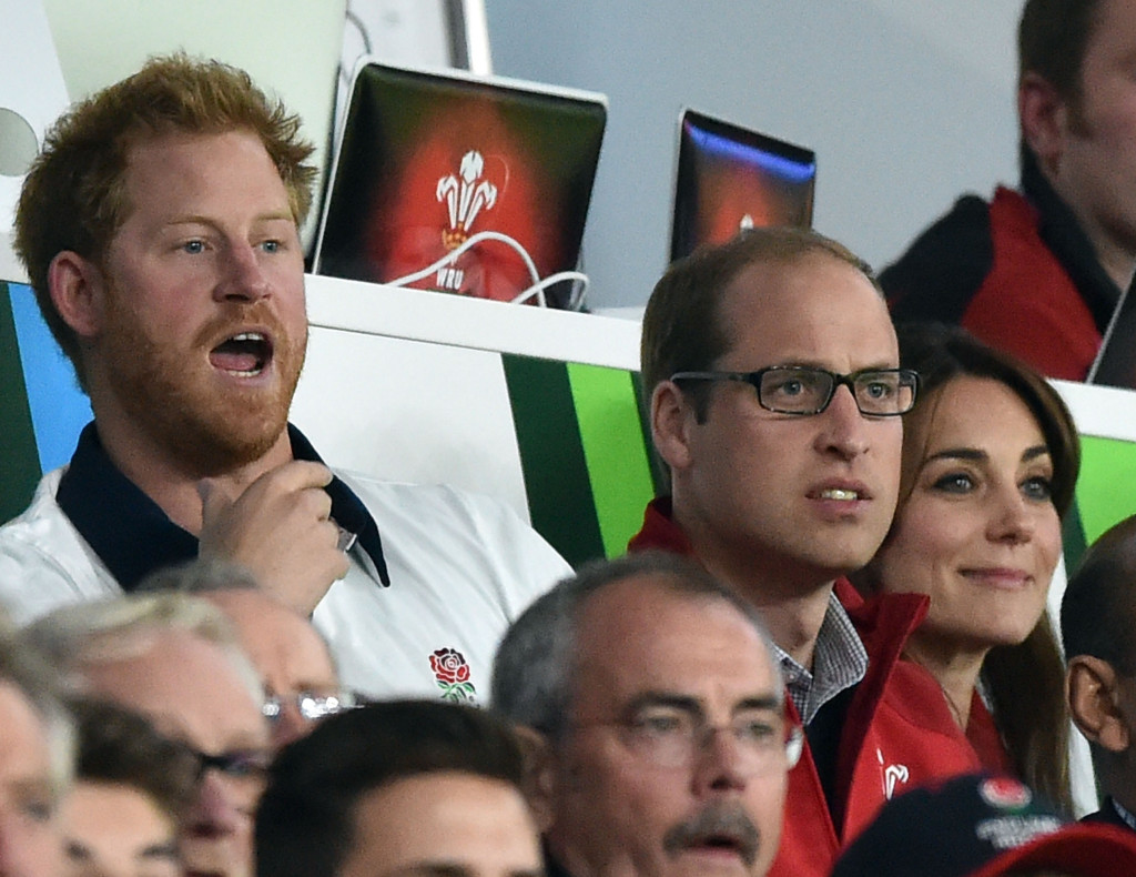 The trio supported opposing team last night. Picture by i-Images
