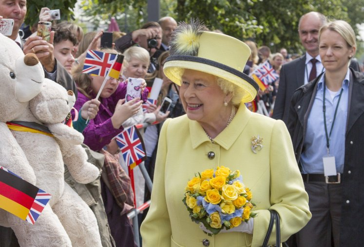 The Queen's official clothes will be displayed alongside her state and ceremonial gowns. Picture by i-Images TOUR POOL