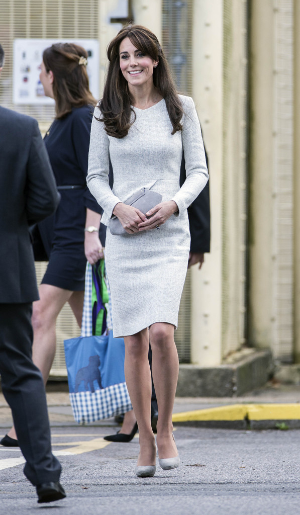 The Duchess of Cambridge departs HMP Send in a grey peplum dress. Picture by i-Images