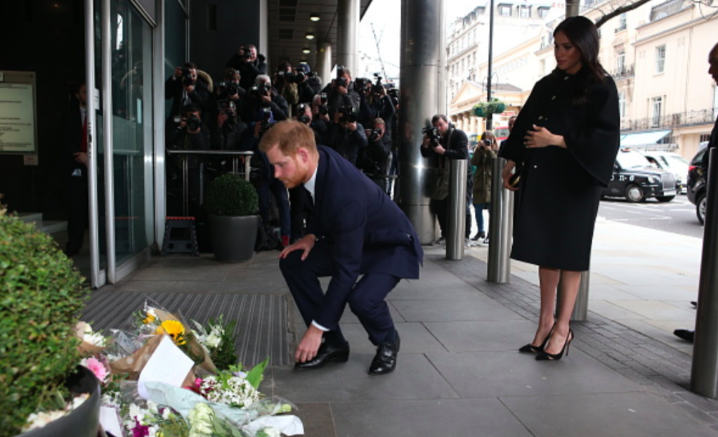 Duke and Duchess of Sussex sign condolence book at New